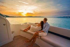 couple cuddling on yacht